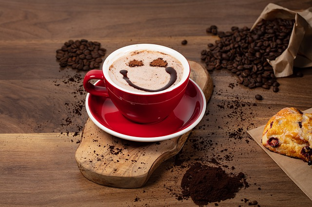 cup of mocha with beans and smiley face in foam